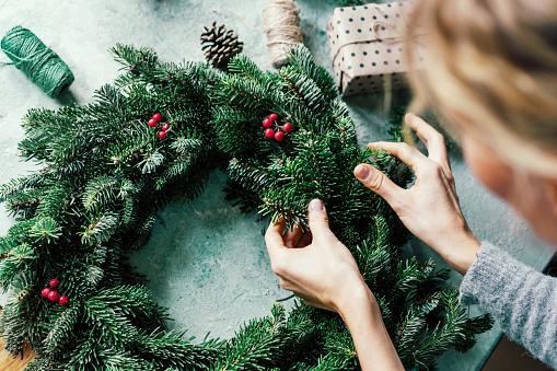 woman making a fir wreath