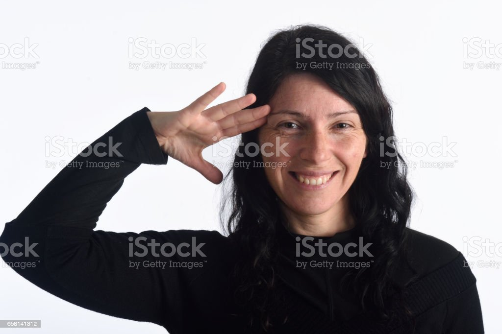 Woman making a military greet stock photo