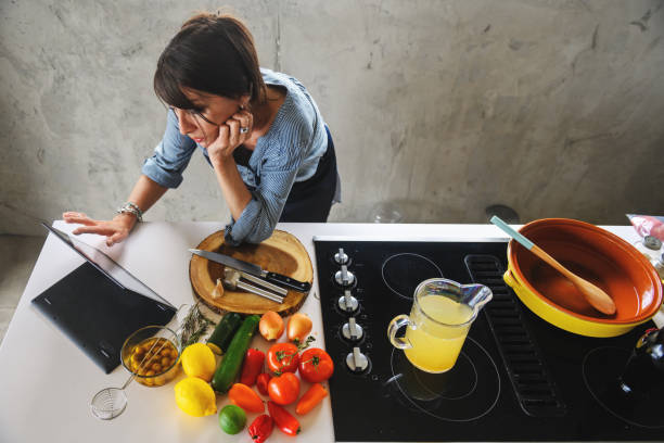 woman making a moroccan tajine - covid stock pictures, royalty-free photos & images