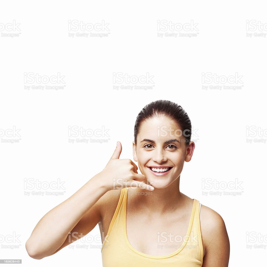 Woman Making a Phone Call Gesture - Isolated royalty-free stock photo
