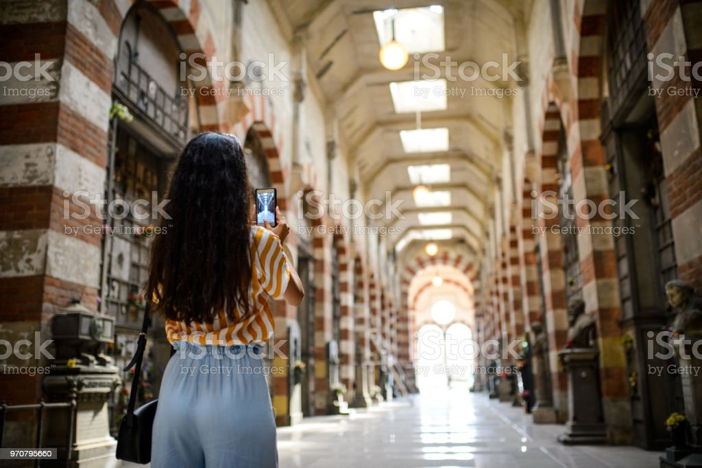 Woman making a photo of a tourist place. stock photo