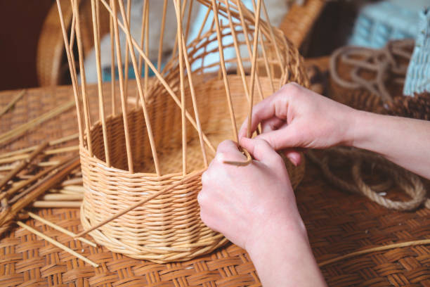 woman making basktes pretty woman making basktes indoor, handmade business craft product stock pictures, royalty-free photos & images