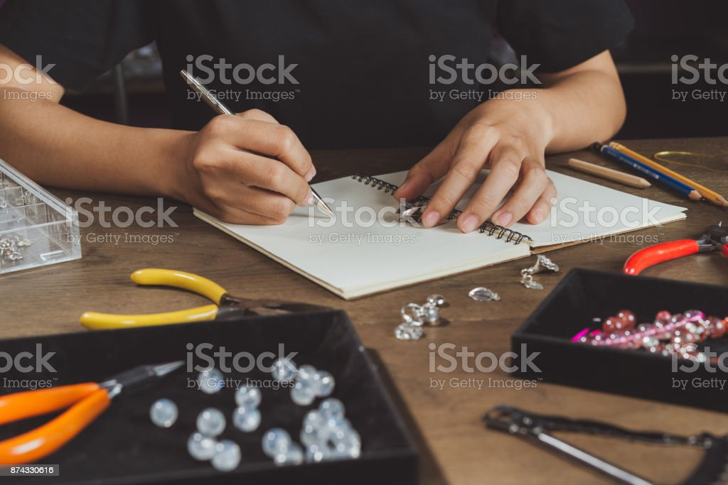 Woman making bears on rustic wooden table stock photo