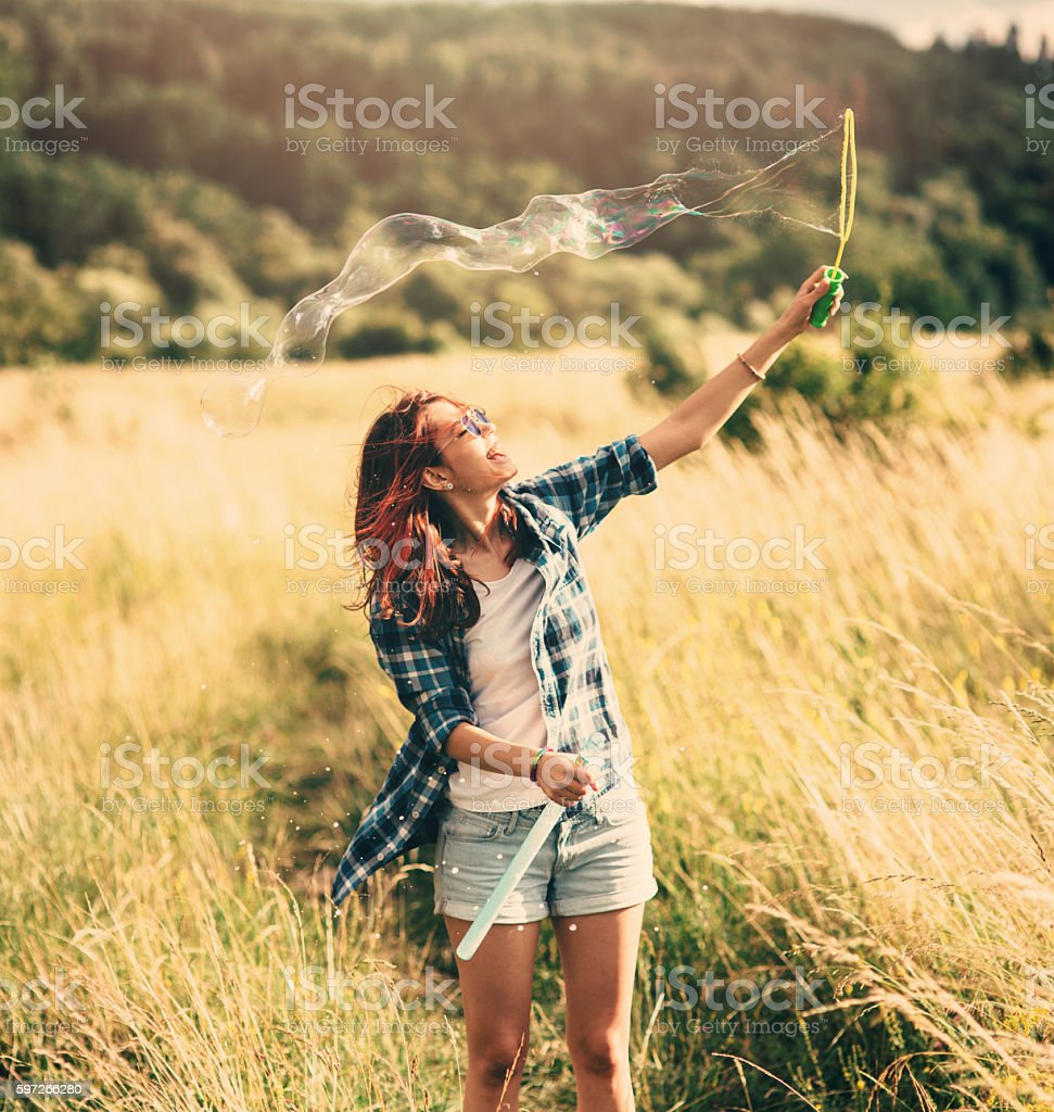 Woman making bubbles royalty-free stock photo