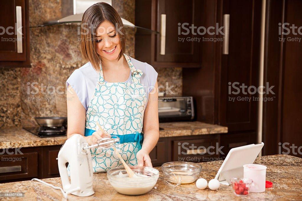 Woman making cake batter stock photo