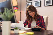 istock Woman making calculations 1042078436