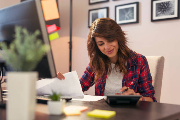 Woman making calculations stock photo