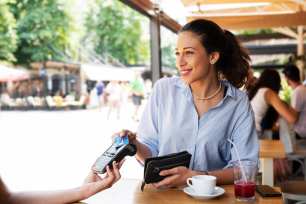 woman making card payment. - contactless payment stock pictures, royalty-free photos & images