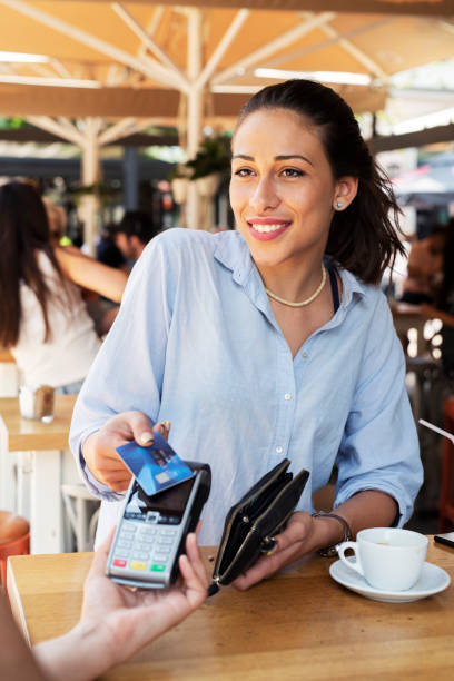 woman making card payment. - paying with card contactless imagens e fotografias de stock