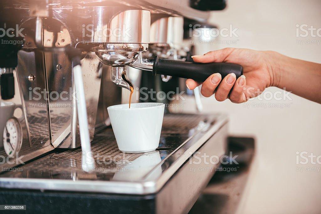 Woman making coffee stock photo