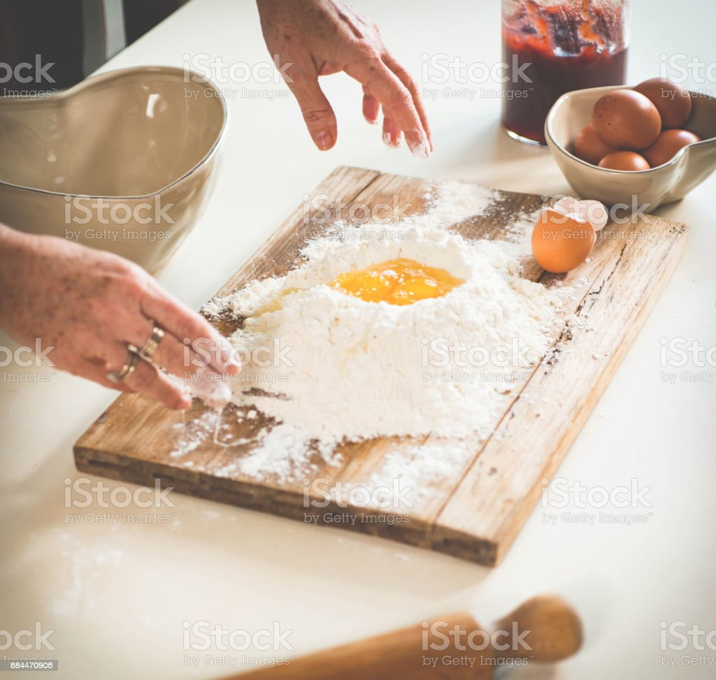 Woman Making Cookies stock photo
