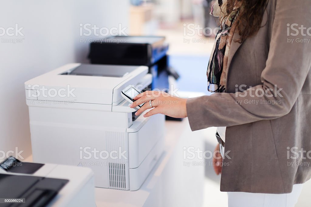 Woman making copies stock photo