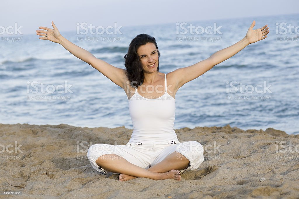 Woman making exercise on the beach royalty-free stock photo