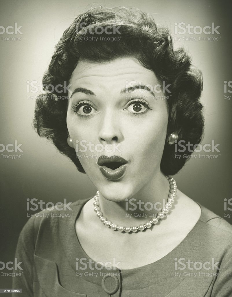 Woman making face in studio, (B&W), close-up, portrait royalty-free stock photo