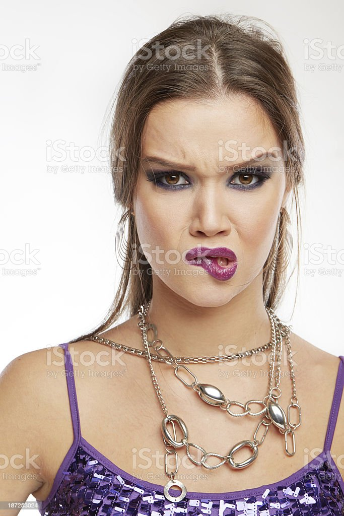 Woman Making Faces: Biting lips stock photo
