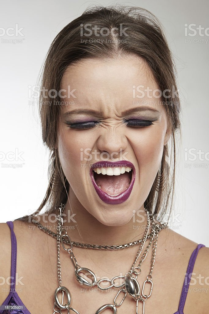 Woman Making Faces: Screaming stock photo