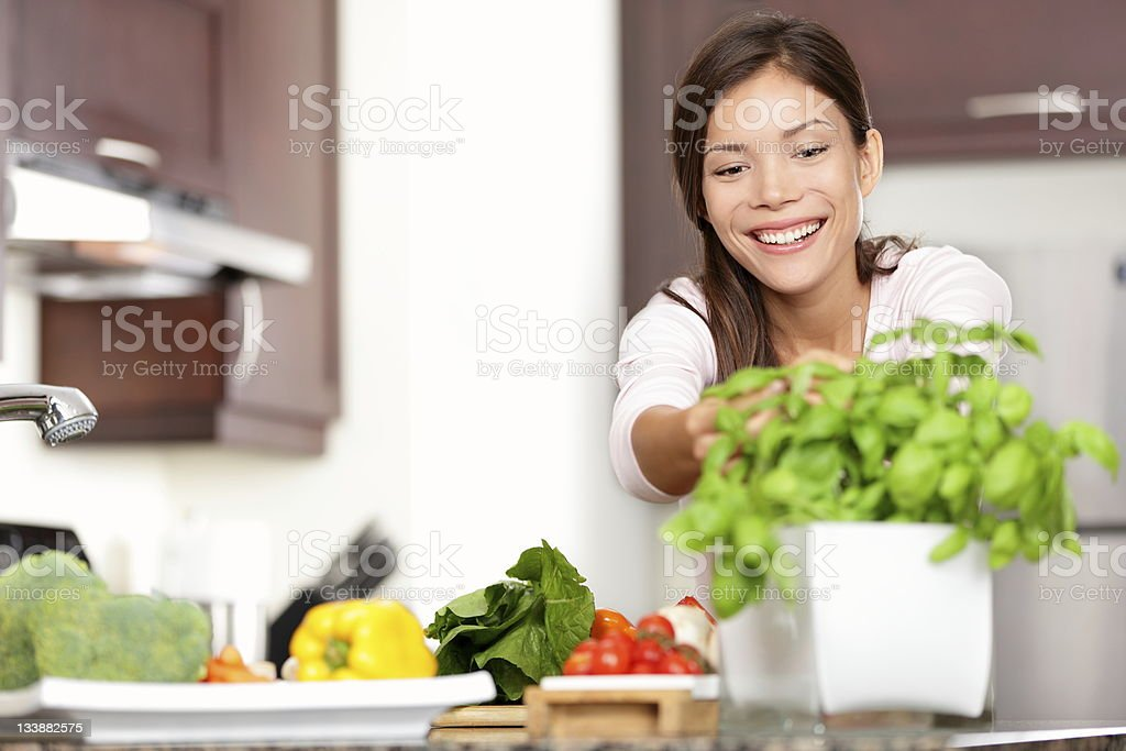 Woman making food in kitchen stock photo