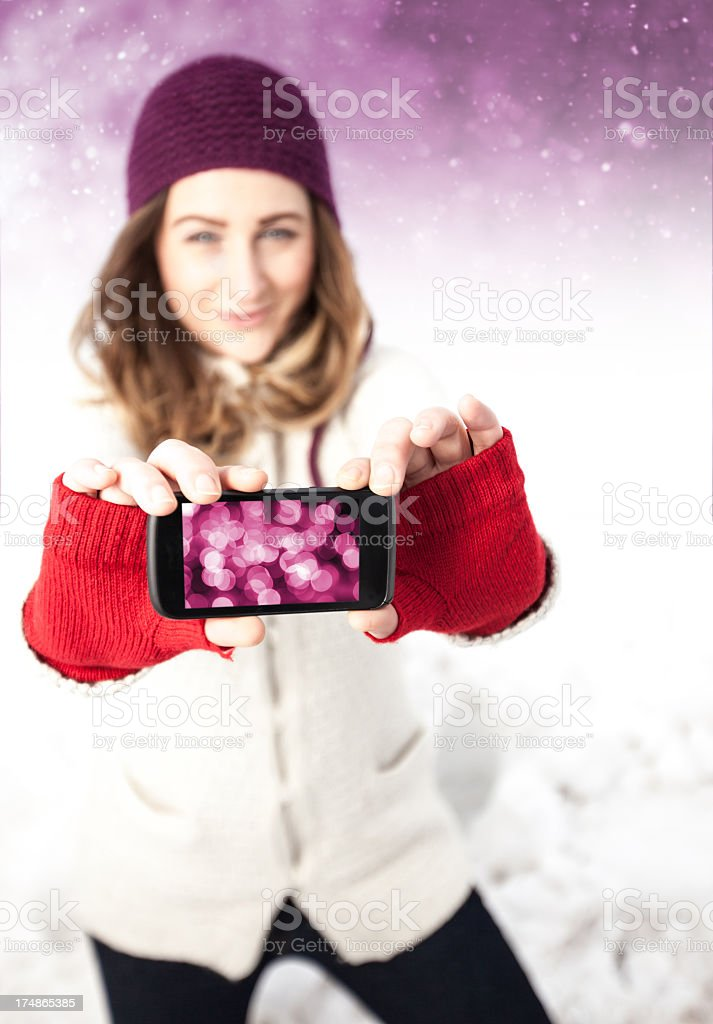 Woman making fun with phone royalty-free stock photo
