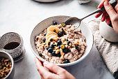 istock Woman making healthy breakfast in kitchen 1249206154