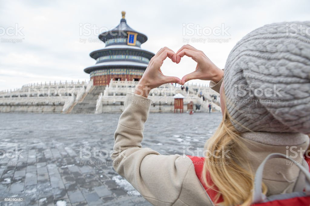 Woman making heart shape finger frame, Temple of Heaven-Beijing stock photo