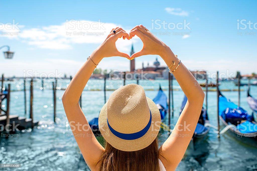 Woman making heart shape in Venice stock photo