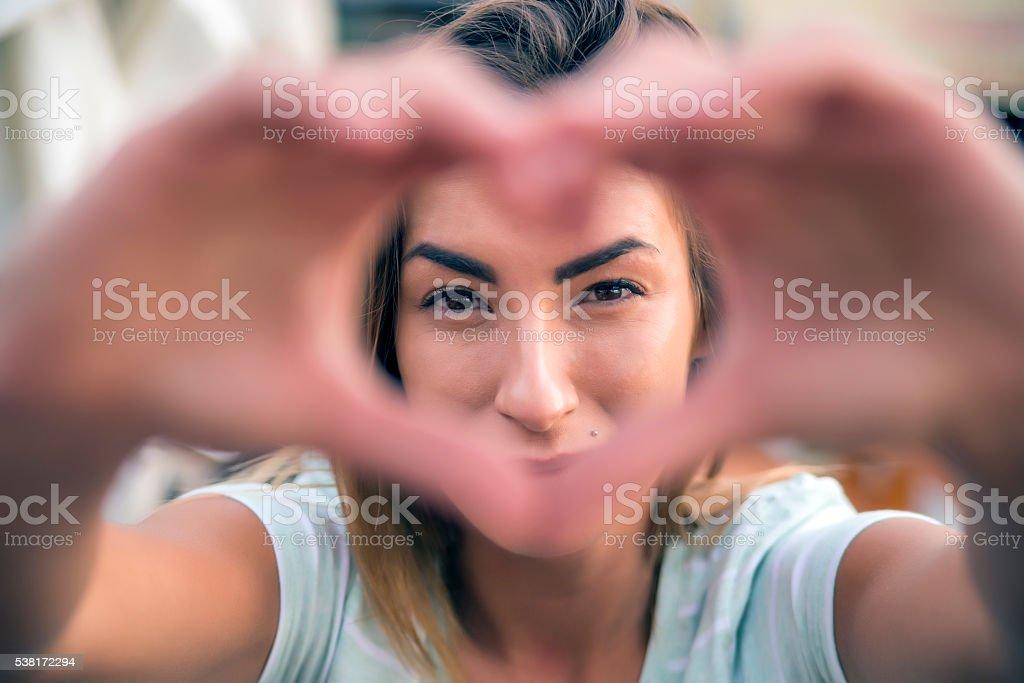 woman making heart shape stock photo