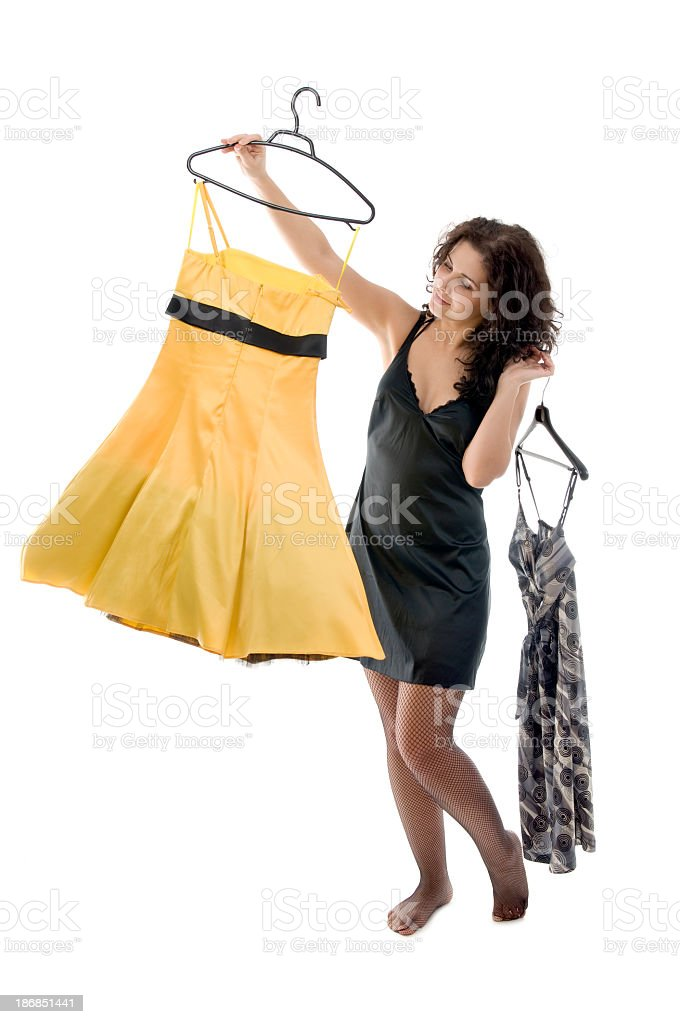 Woman making her dress choice royalty-free stock photo