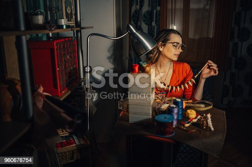 512345816istockphoto Woman making necklace in the workshop 960676754
