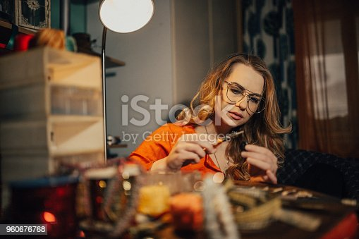 512345816istockphoto Woman making necklace in the workshop 960676768