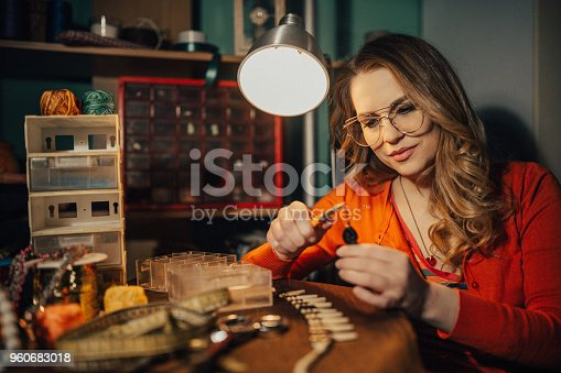 512345816istockphoto Woman making necklace in the workshop 960683018
