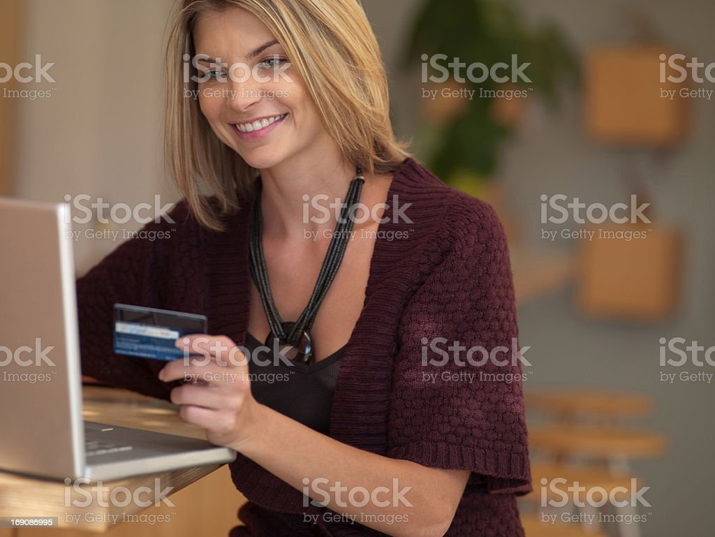Woman making online purchase royalty-free stock photo