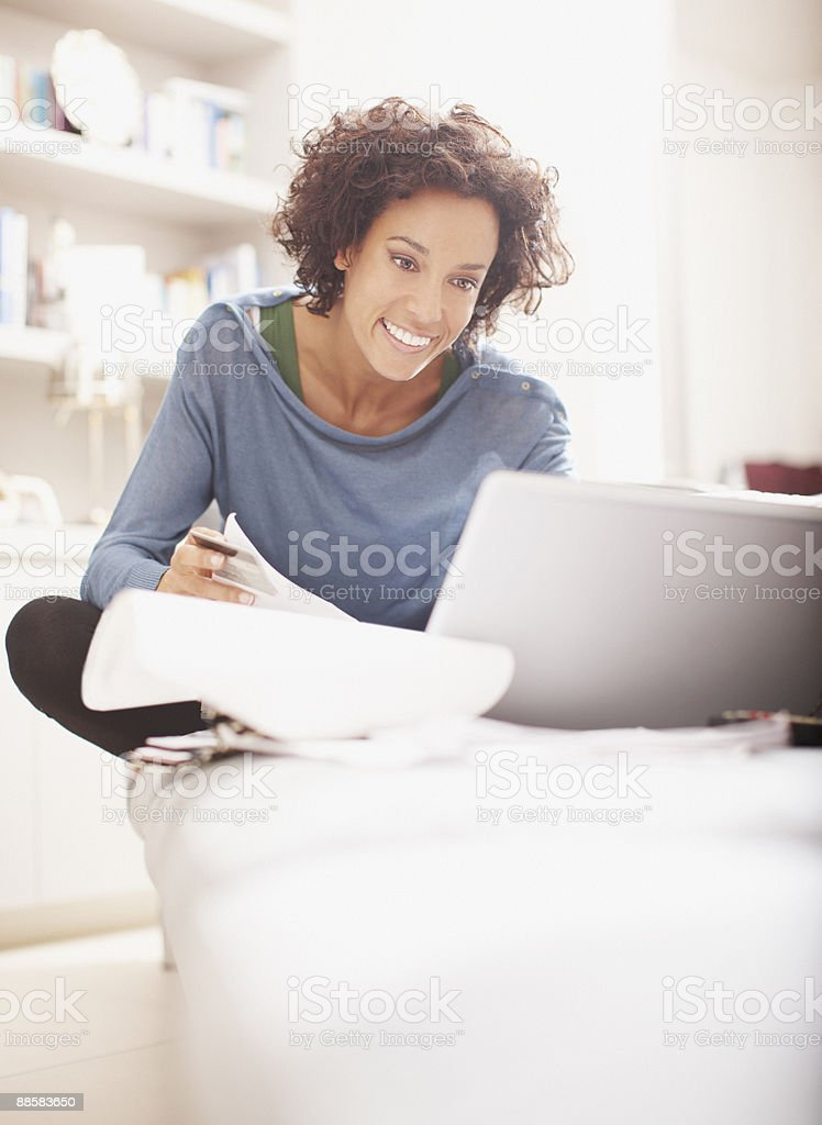 Woman making online purchase stock photo