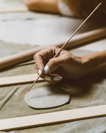 istock Woman making pattern on ceramic plate, drawing. Creative hobby concept. Earn extra money 1209033152