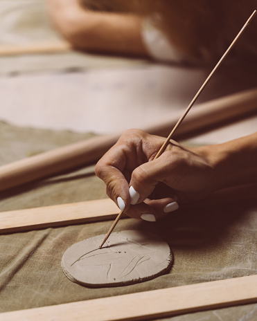istock Woman making pattern on ceramic plate, drawing. Creative hobby concept. Earn extra money 1211785062