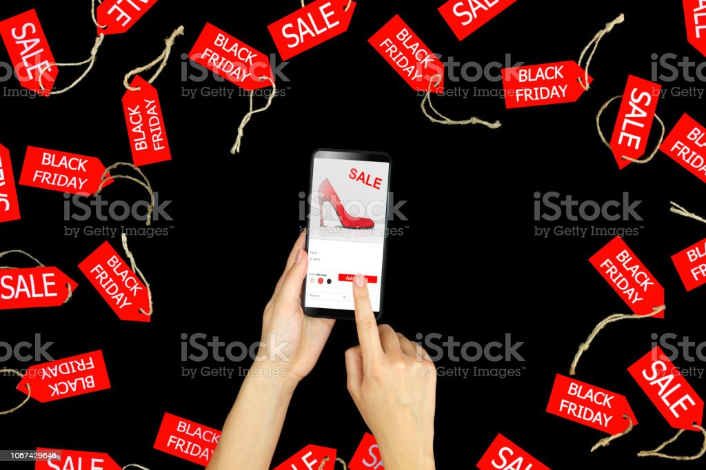 Woman Making Payment On Fashion Internet Shop During Black Friday Stock Photo Download Image Now Istock