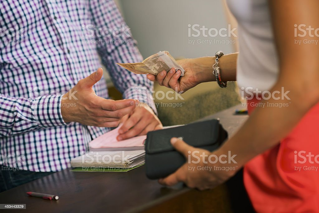 Woman making payment to service provider stock photo