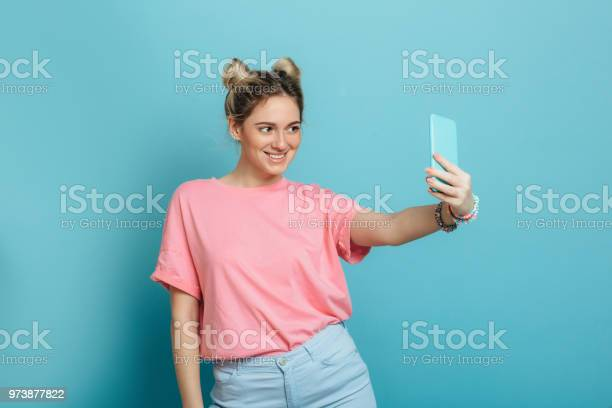 Woman making photo on her smartphone on blue background picture id973877822?b=1&k=6&m=973877822&s=612x612&h=ko izhec4nahdniymsf29ugs0hsol6agp3xcringnr8=