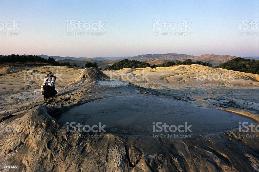 woman making photos of muddy volcanoes royalty-free stock photo