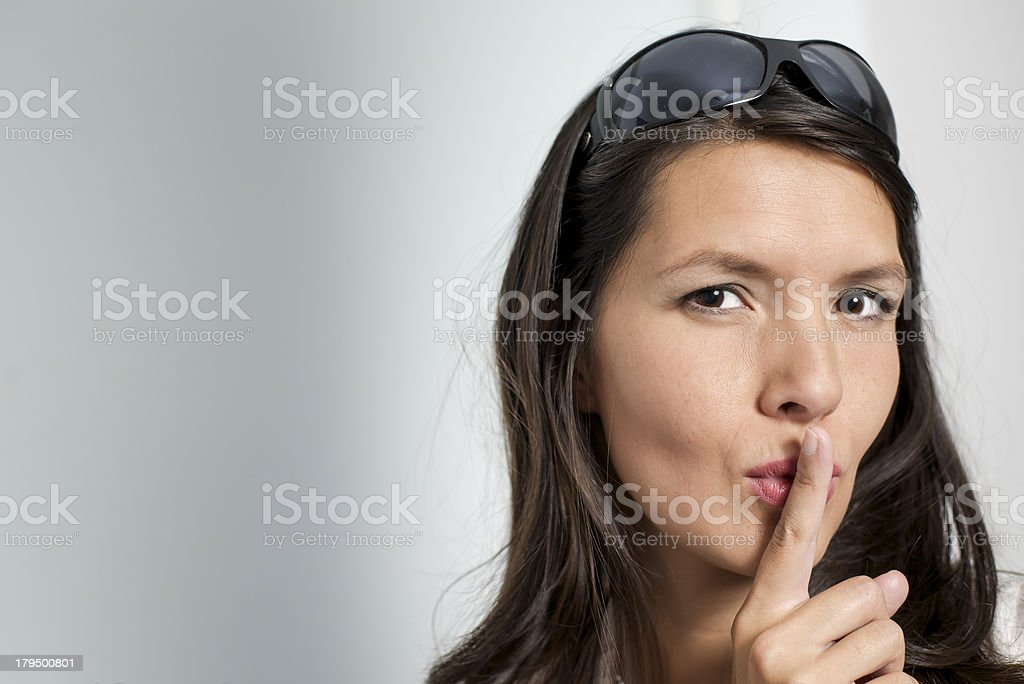 woman making psst gesture stock photo