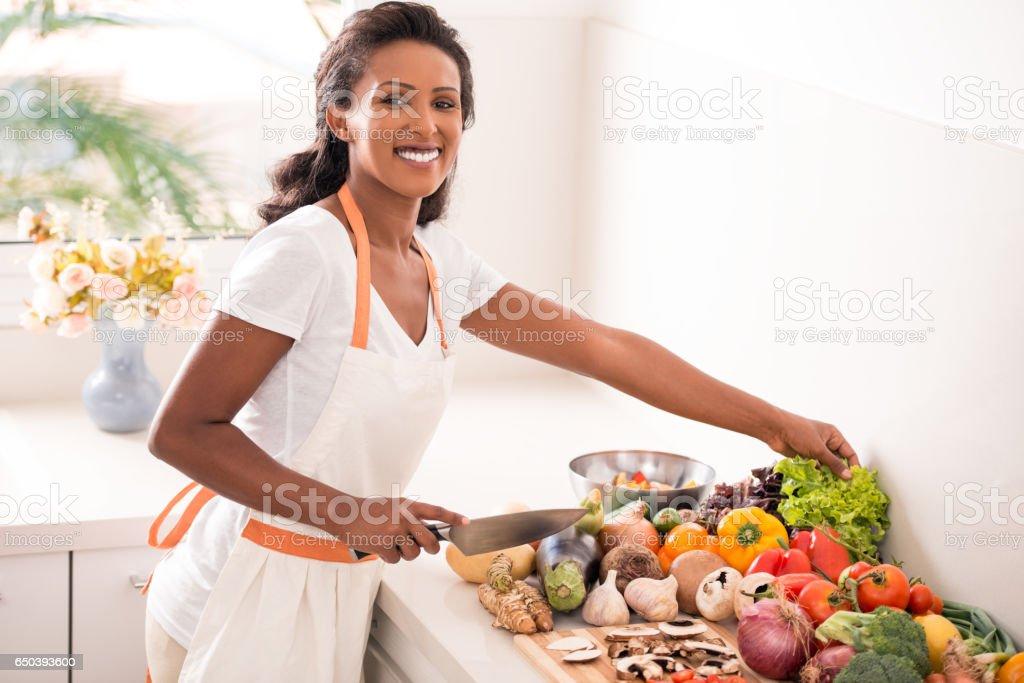 Woman making salad. stock photo