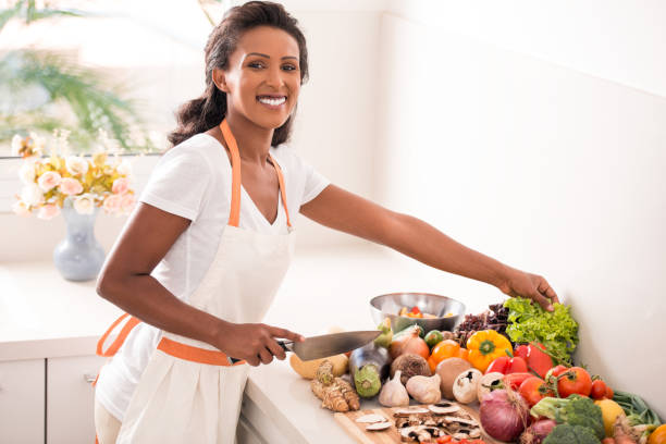woman making salad. - nutritionist stock photos and pictures