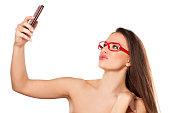 istock woman making selfie 469474634