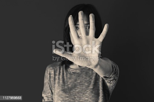 istock Woman making stop gesture with her hand 1127959553
