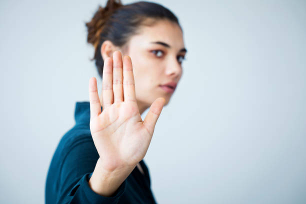 Woman making stop gesture with her hand stock photo