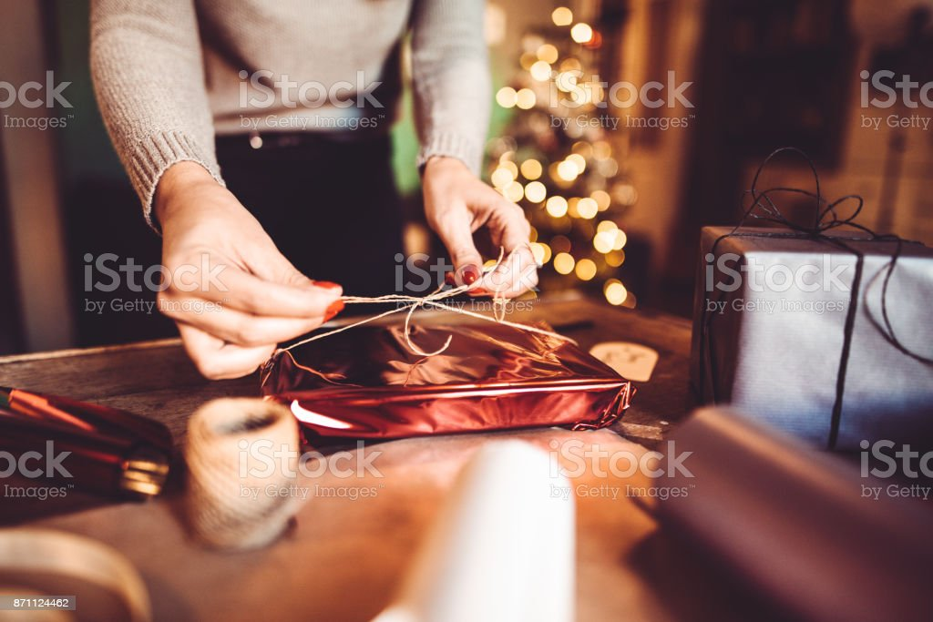 woman making the package for the christmas gift stock photo