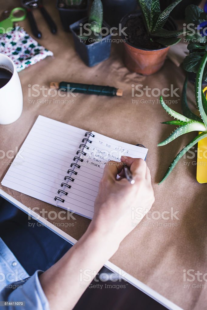 Woman making to do list stock photo