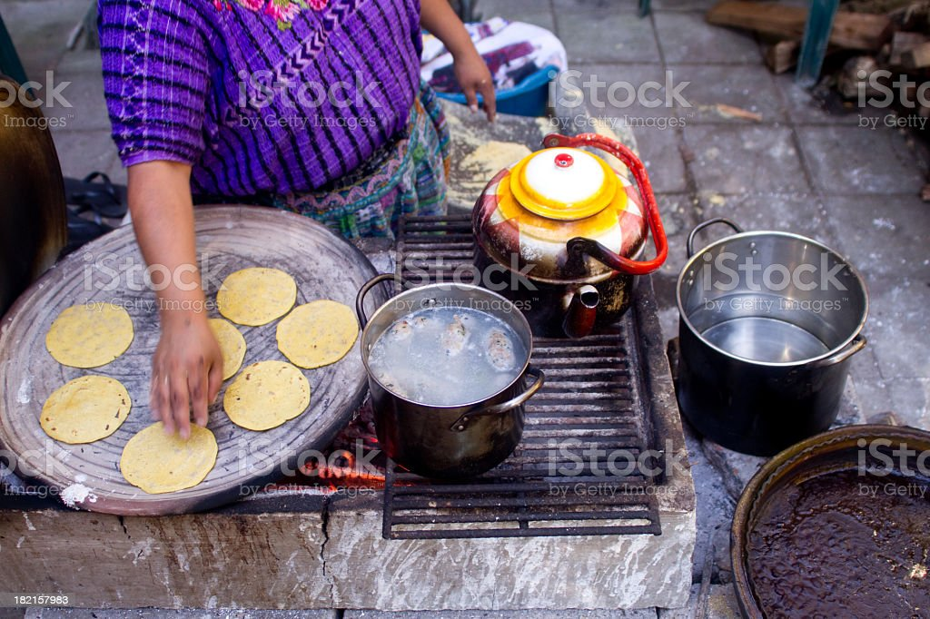Woman making Tortillas stock photo