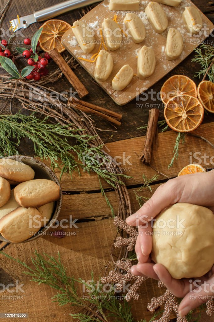 Woman making traditional Pebber Nodder Danish traditional Christmas cookie shortbread stock photo