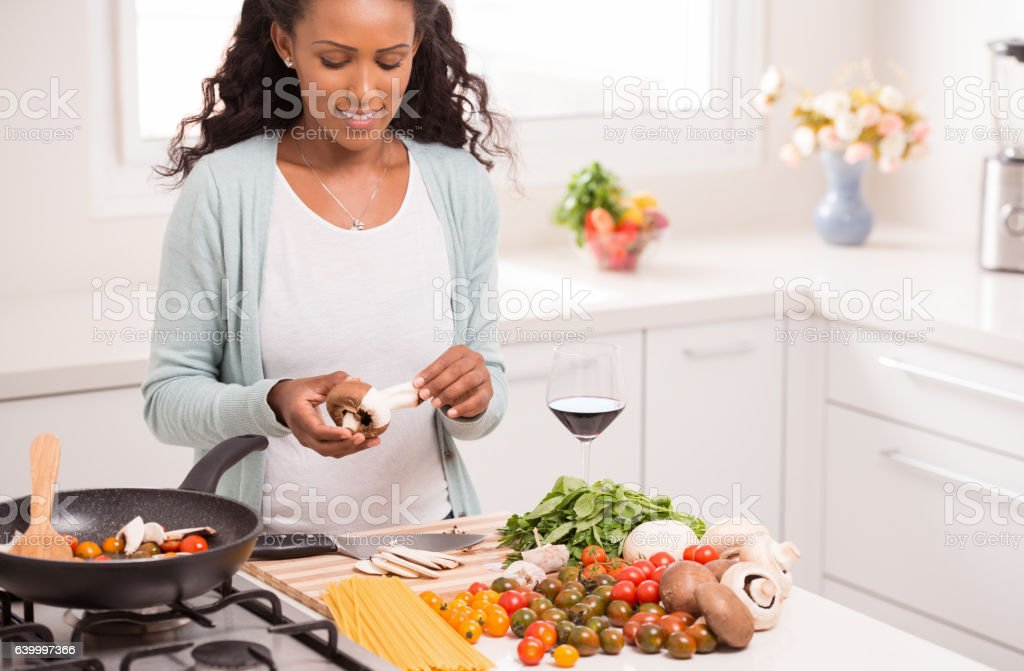 Woman making vegetarian dinner. stock photo