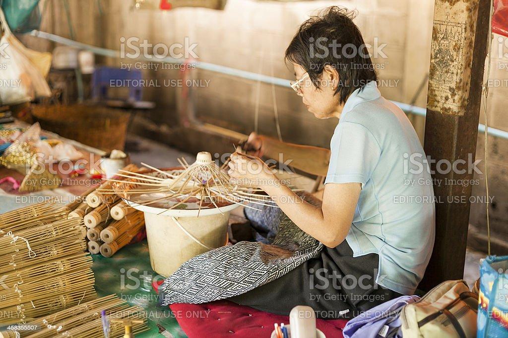 Woman making wooden umbrellas stock photo